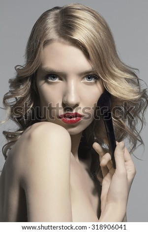 beautiful girl model red lipstick beauty shot black and white monochrome makeup brush make up beauty perfect skin blond hair gloss beauty care spa dark sexy attractive sensual glamour face portrait - stock photo