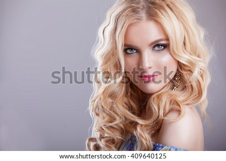 beautiful girl model woman portrait professional makiyad and hair in a flower dress on a floral background , bright tone , pink lips , blonde hair , blonde curls sound around , very cute and beautiful - stock photo