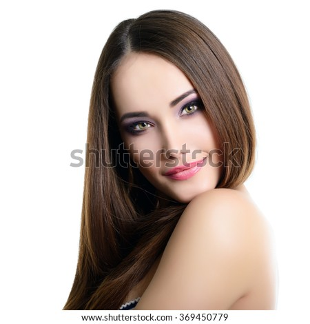 Beautiful girl. Natural beauty portrait. Young woman with beautiful healthy face and long brown hair looking at camera. Studio shot of attractive fresh girl over gray background. - stock photo