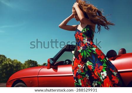 Beautiful girl near the car. Traveler. - stock photo