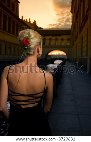Beautiful girl near the river at sunset time - stock photo
