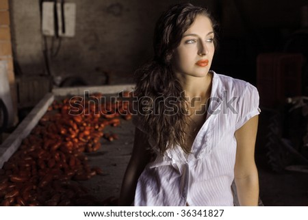 beautiful girl next to fresh tomatoes - stock photo
