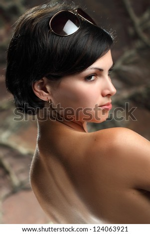 beautiful girl on a background of a stone wall - stock photo