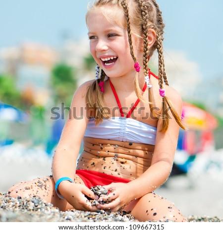 beautiful girl on a beach on the coast - stock photo