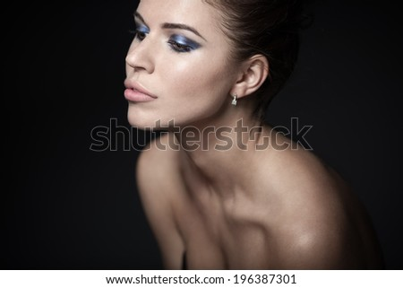 Beautiful girl on a black background - stock photo