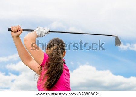 beautiful girl on a green lawn with a golf club posing - stock photo