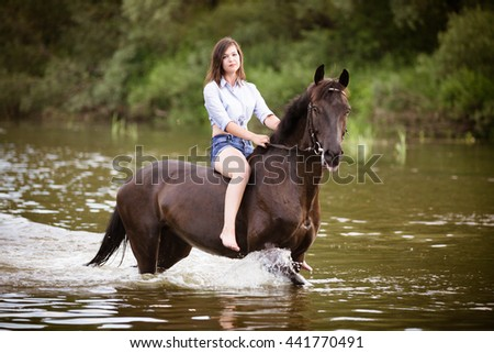 Beautiful girl on a horse