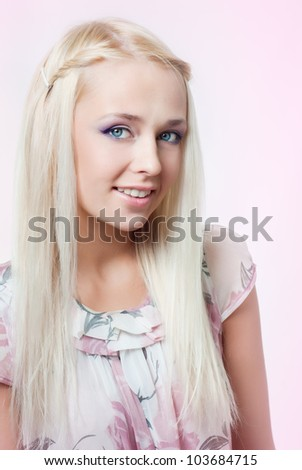 Beautiful girl on a pink background - stock photo
