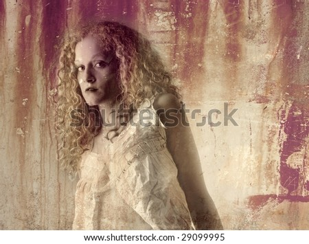 beautiful girl on a rusty background - stock photo