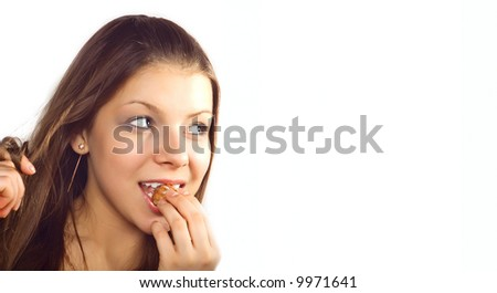 Beautiful girl on a white background eats