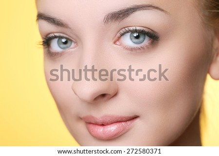 Beautiful girl on a yellow background