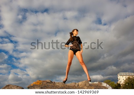 Beautiful girl on background sky - stock photo