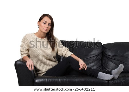 Beautiful girl on black couch relaxing