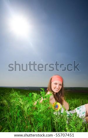 Beautiful girl on grass - stock photo