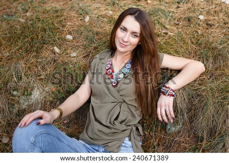 beautiful girl on nature in the forest - stock photo