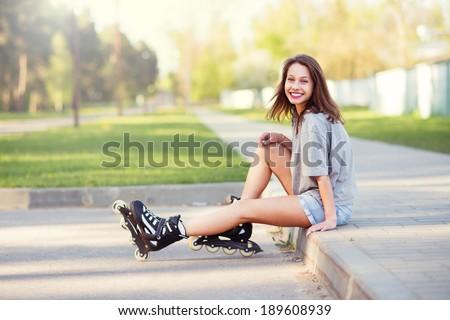 beautiful girl on roller skates - stock photo