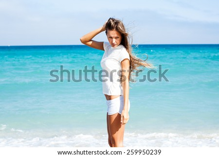 beautiful girl on the beach  - stock photo