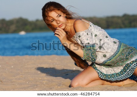 beautiful girl on the beach in summer - stock photo