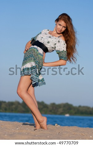 beautiful girl on the beach in summer - stock photo