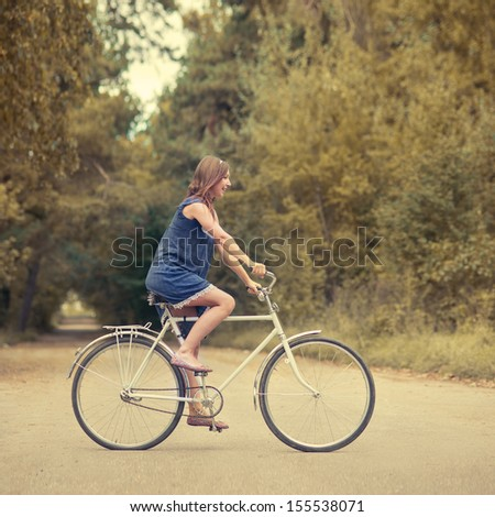beautiful girl on the bike - stock photo