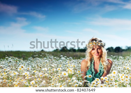 beautiful girl on the daisy flowers field - stock photo