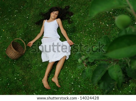 Beautiful girl on the grass