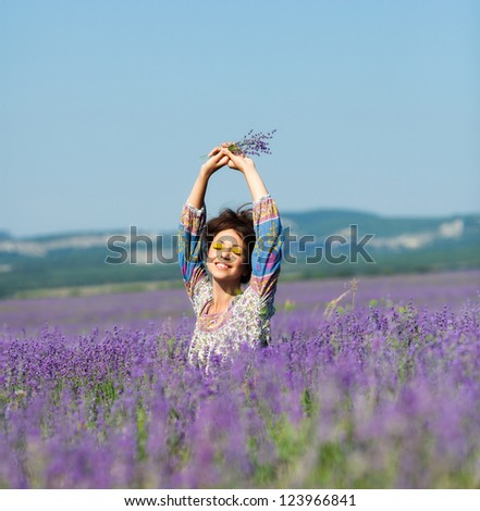 Beautiful girl on the lavender field - stock photo