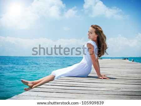 Beautiful Girl on The Pier. Ocean. Vacation - stock photo