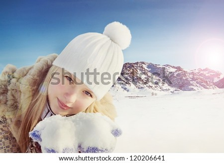 Beautiful girl on the winter background with  mountain - stock photo