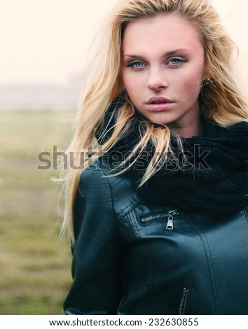 Beautiful girl outdoor  close-up portrait - stock photo
