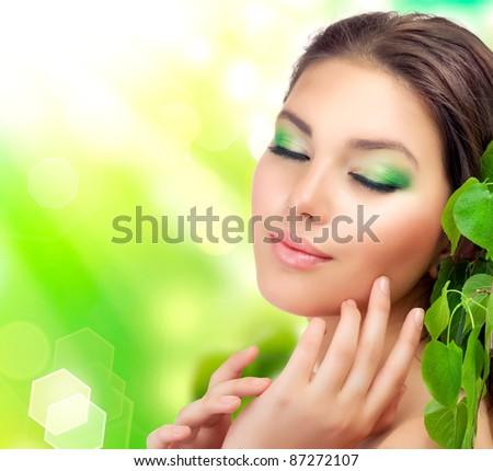 Beautiful Girl outdoors applying the natural cosmetics. Perfect fresh skin - stock photo