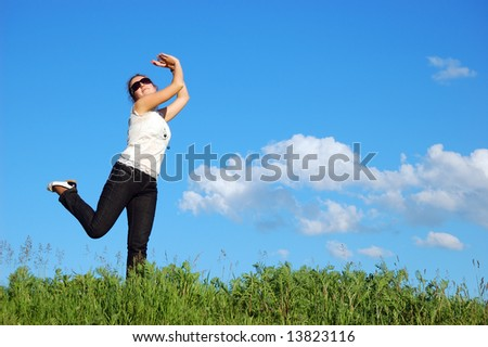 Beautiful girl over a blue sky with clouds