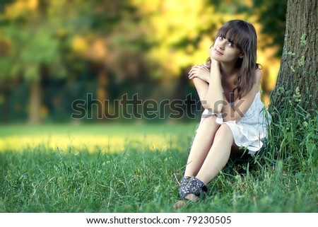 Beautiful girl over nature background.