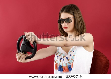 beautiful girl playing 3D video game isolated on red background - stock photo