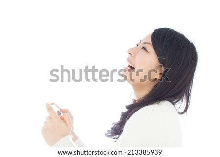 beautiful girl playing handheld video game isolated on background - stock photo
