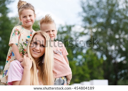 beautiful girl playing with her children