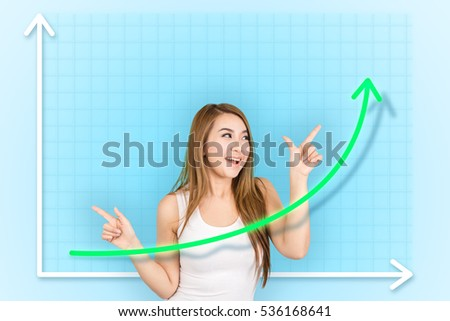 Beautiful girl pointing to the graph that showing profit growth on virtual screen