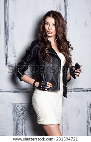 Beautiful girl portrait in rock style - stock photo