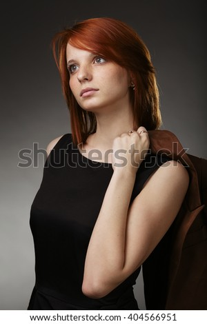 beautiful girl portrait on dark background - stock photo