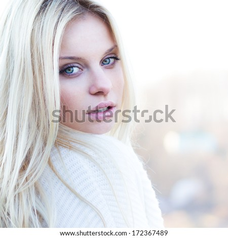 Beautiful girl portrait outdoor in sunny weather - stock photo