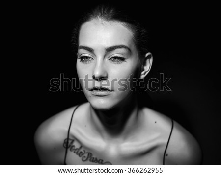 Beautiful girl portrait with gorgeous green eyes black and white - stock photo