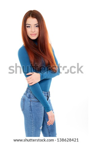 beautiful girl portrait with long red hair in blue sweater and jeans over white studio shot - stock photo