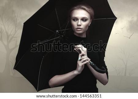 Beautiful girl portrait with umbrella - stock photo