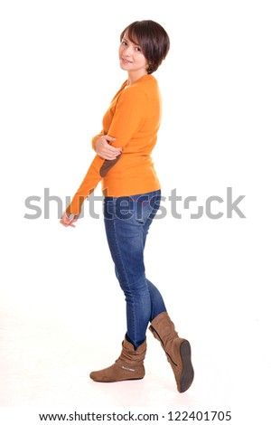 beautiful girl posing in orange on a white background