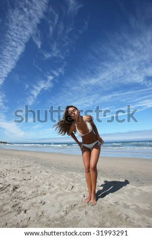 beautiful girl posing in the beach - stock photo