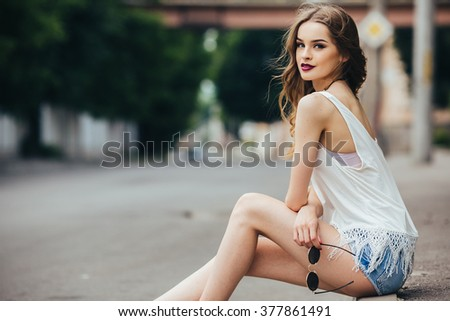 beautiful girl posing in the city on the street - stock photo