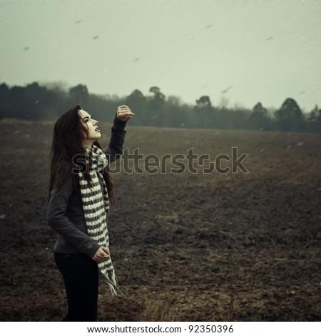 Beautiful girl posing in the rain - stock photo