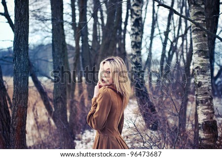 Beautiful girl posing in the woods - stock photo