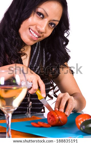 Beautiful Girl Preparing Food and Drinking Wine - stock photo