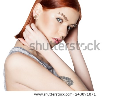 beautiful girl punk with piercing, red hair, tattoo and perfect skin - stock photo